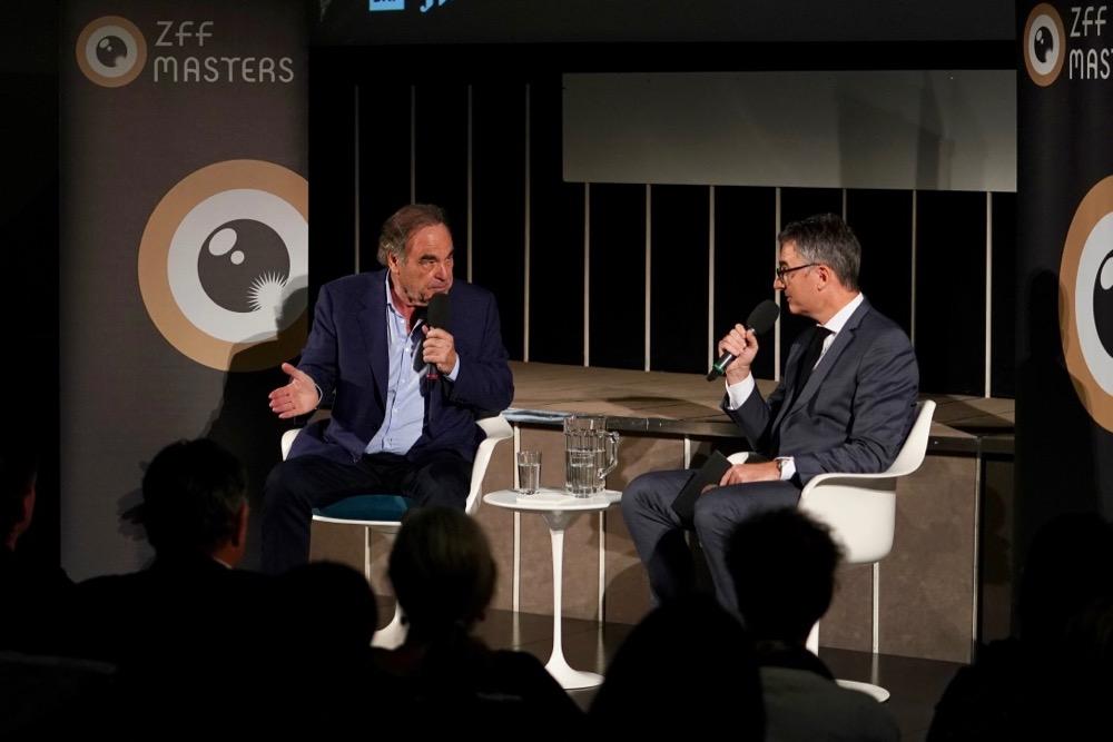 Oliver Stone und Christian Jungen im Gespräch bei den ZFF Masters